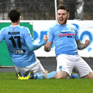 Flying high: Cathair Friel celebrates with Andy McGrory after scoring against Cliftonville on Saturday