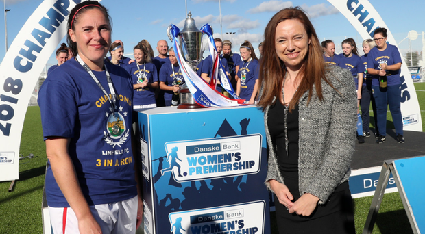 First Ladies: Sarah Venney and Linfield Ladies celebrate last season's title with Vicky Davies from Danske Bank
