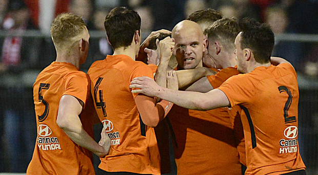 Happy days: Carrick, including Lukasz Adamczyk (centre), celebrate against Portadown