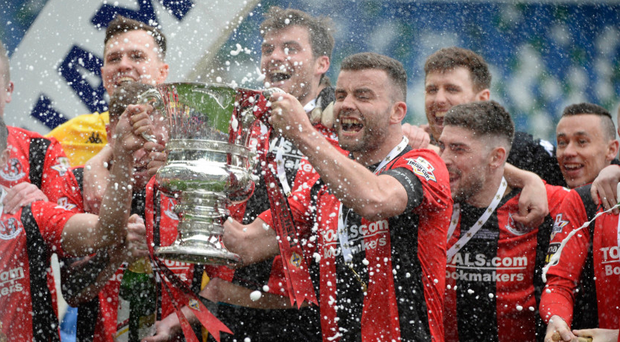 Glory days: Crusaders captain Colin Coates lifts the Irish Cup