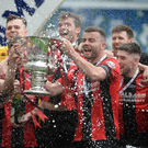 Glory days: Crusaders captain Colin Coates lifts the Irish Cup after last season's final