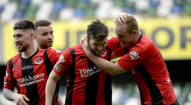 Get in: Philip Lowry is congratulated by Jordan Owens