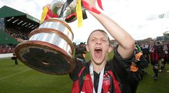 Silver lining: Crusaders' Matthew Snoddy lifts the Setanta Sports Cup in 2012