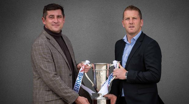 Hold tight: Derry City manager Declan Devine (left) and Dundalk boss Vinny Perth with EA Sports Cup ahead of tomorrow night's final at the Brandywell