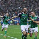 Gareth McAuley celebrates after hitting opener against Ukraine at Euro 2016