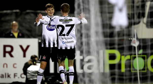 All smiles: Dundalk's Daniel Kelly celebrates last night