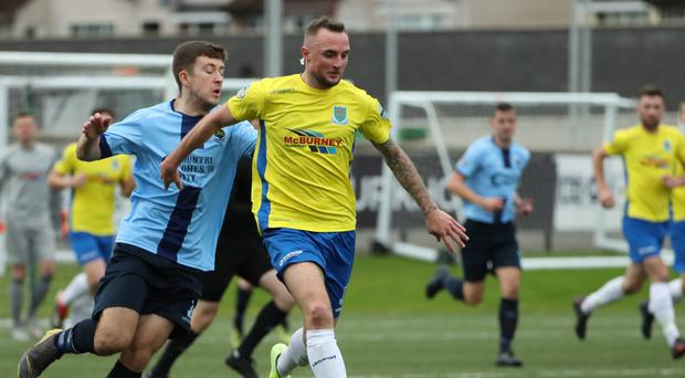 Race on: Ballymena United ace Jude Winchester tries to escape Shane McNamee
