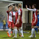 Get in: Linfield's Jimmy Callacher (far left) celebrates his goal at Dungannon last night