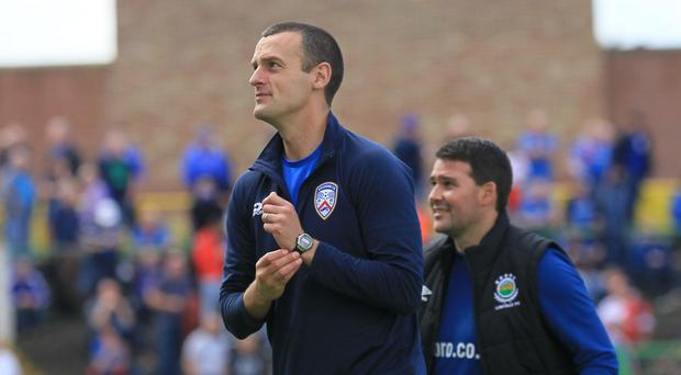 Facing off: Oran Kearney and David Healy are set to do battle
