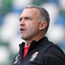 Glentoran football manager Mick McDermott has hit out immigration authorities after his wife of 23 years was refused a visa to live in Northern Ireland.