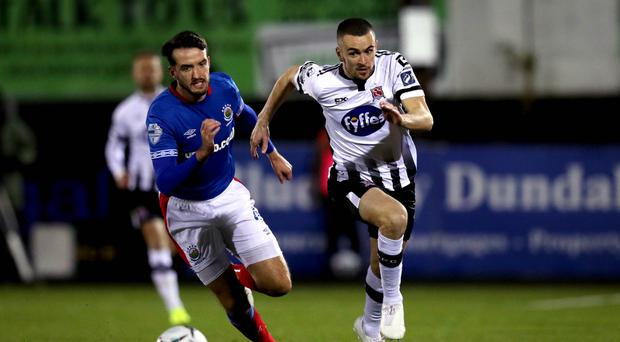 Out of reach: Dundalk's Michael Duffy sprints away from Josh Robinson