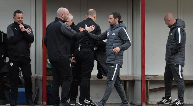 Action stations: Tiernan Lynch (right) will renew touchline rivalries with Cliftonville boss Paddy McLaughlin tomorrow