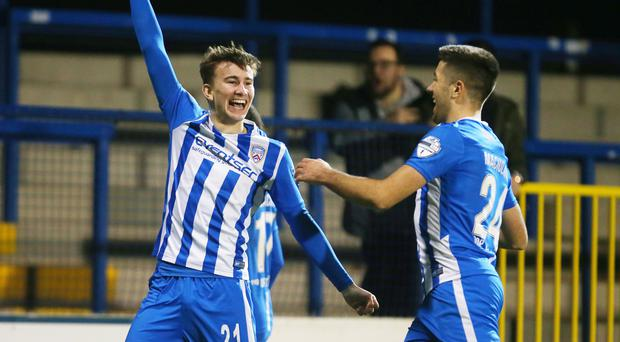Final say: Alexander Gawne celebrates his late winner for Coleraine on Saturday
