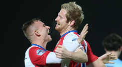 Blues brothers: Linfield goalscorer Ryan McGivern (right) celebrates with Andrew Mitchell