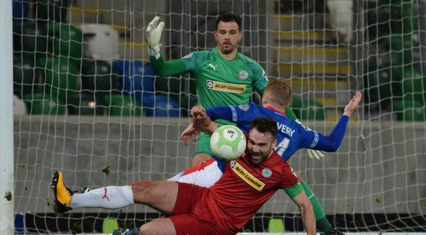 Sudden halt: Jamie Harney has become a pillar in the Cliftonville defence