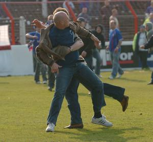 Ugly scenes: Sadly April 23, 2005 will also be remembered for the disgraceful behaviour at the Oval when fans invaded the pitch and running battles took place
