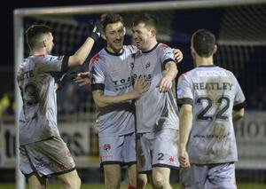 Three and easy: Billy Joe Burns (third from left) celebrates with his Crusaders team-mates