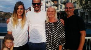 The trio with Richard's mum Lyn and dad Paul