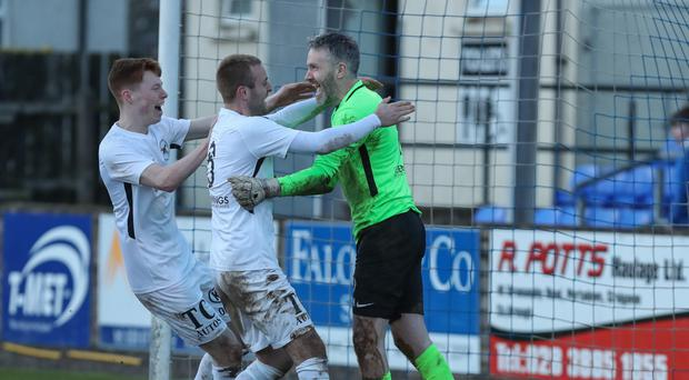 Spot on: John Connolly accepts the plaudits after Ballinamallard's penalty shoot-out victory