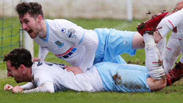 Three and easy: Hat-trick hero Andy McGrory is mobbed by Ballymena teammates Ryan Mayse and Adam Lecky