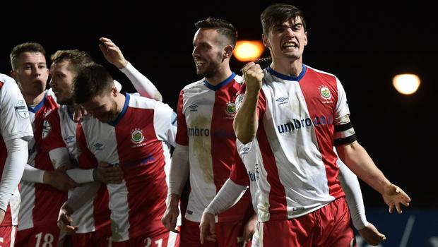 Big step: Linfield ace Jimmy Callacher shows his delight after netting at the Ballymena Showgrounds