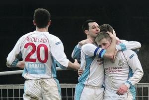 King David: Ballymena goalscorer David Cushley is mobbed after bagging the winner