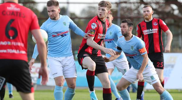 Spot of trouble: Ballymena midfielder Ryan Harpur concedes a penalty as the ball strikes his arm