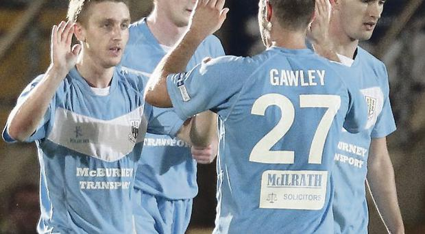 Winning combination: Ballymena's Alan Teggart celebrates with his teammates after scoring a late winner at the Showgrounds last night