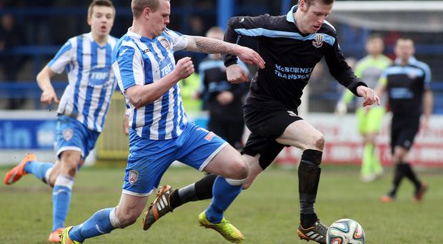 On the move: Darren Boyce takes on Coleraine's Aaron Canning