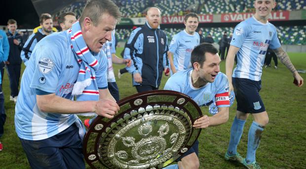 Shield of dreams: Ballymena United aces Jim Ervin and Allan Jenkins parade the County Antrim Shield at Windsor Park