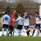 Ballymena's David Cushley is sent off as Ballinamallard celebrate the penalty award