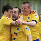 Spot on: Tony Kane (centre) and team mates celebrate his goal