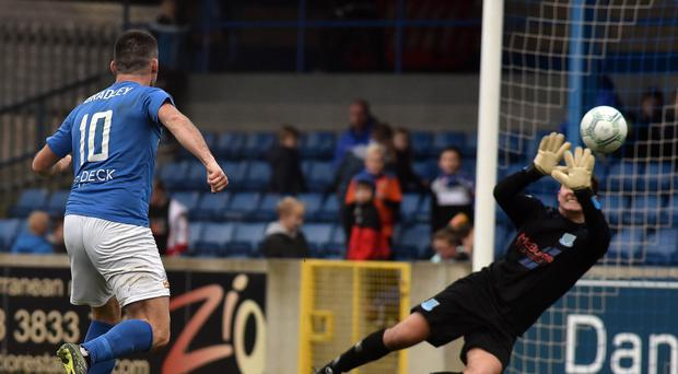 Net gains: Eoin Bradley blasts Glenavon's fourth goal past Ballymena keeper Ben McCauley