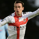 Cutting edge: Paul Heatley celebrates his double in Crusaders'opening-night victory over Ballymena United at the Showgrounds