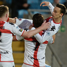 On the up: two-goal hero Paul Heatley is hoisted skyward as Crusaders began the new Premiership season with a big win at Ballymena