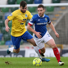 On the run: Linfield's Jamie Mulgrew expects a Ballymena response today