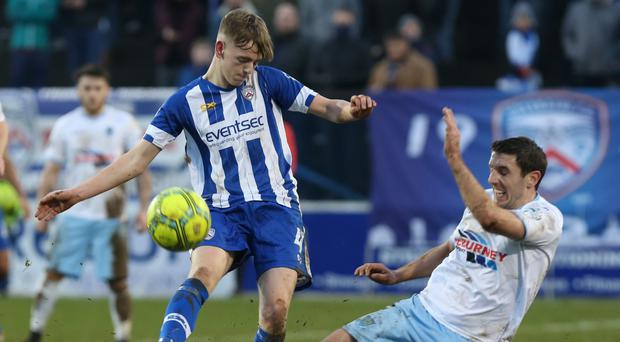 Getting a foot in: Ballymena United ace Gary Thompson tackles Ciaron Harkin of Coleraine