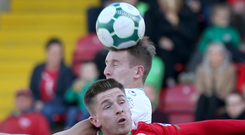 Head boy: United's Jonny Addis gets the better of Ryan Curran