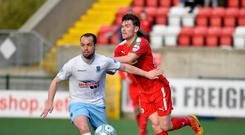 Aiming high: Tony Kane (left) in action for Ballymena against Cliftonville