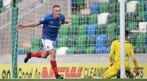 Making a mark: Linfield's Michael O'Connor wheels away after scoring his side's equaliser