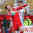 Scrap: Scot Whiteside grapples with the Reds' Ryan Curran