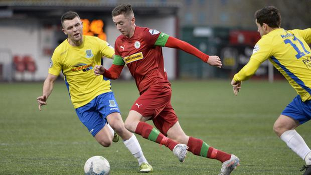Forward motion: Ronan Doherty steers his way past United's Shane McGinty