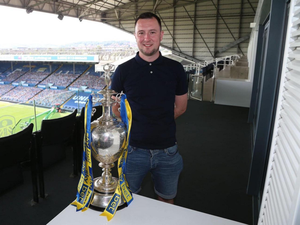 Going up: Youth coach and Leeds fan Thomas McStravick was overjoyed with the Elland Road club's title win