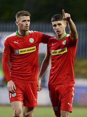 Brothers in arms: Jay Donnelly (right) celebrates hit two-goal blast with brother Rory