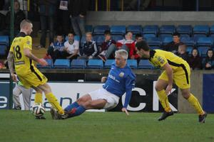 Gone to ground: Glenavon's William Murphy makes a tackle on Cliftonville's Jude Winchester which earned him a red card