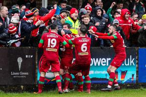 Fan boy: Michael McCrudden is mobbed after opening the scoring