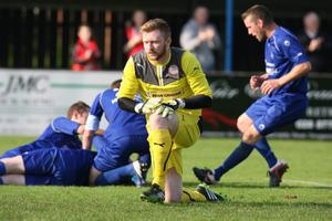 Cliftonville goalkeeper Conor Devlin has allowed his own high standards to drop, spilling shots that led to goals against Glenavon and the Swifts