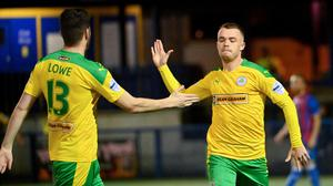 Get in: Cliftonville's Chris Gallagher (right) celebrates his goal last night with team-mate Kris Lowe