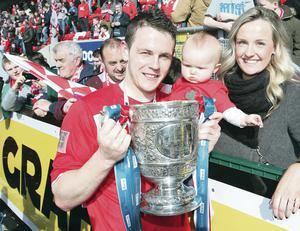 Jaimie McGovern celebrates last season's title triumph with fiancee Colette and daughter Miya