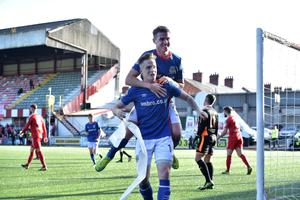 Wanted man: Linfield's Aaron Burns has attracted attention from several clubs with Barry Gray's Cliftonville particularly keen on the midfielder